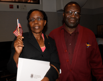 Philomene Uwamariya, a native of Rwanda, left, became a U.S. citizen Friday. Her husband Manasse Karuhura, would like to become a citizen, also.