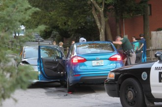 Police search the vehicle on Kennard Street.