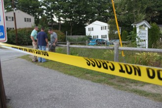 Crime tape blocks Kennard Street at Mammoth Road.
