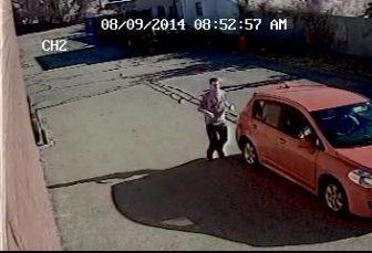 Surviellance photo of alleged pizza shop robber.