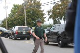 A NH State Police trooper outside West High School.