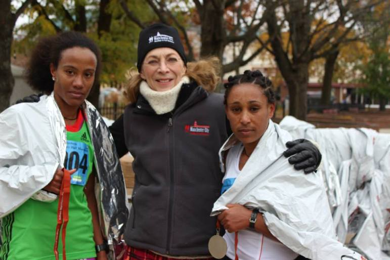 Katherine Switzer, center, takes a moment to pose with two of the Top 3 female finishers in the 2013 Manchester City Marathon half-marathon finishers. 2013