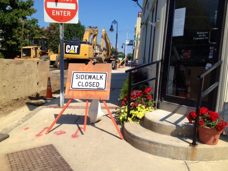 Construction signs outside The Beanstalk Cafe doorstep.