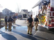 Firefighters wrap up after garage fire on McDuffie Street.