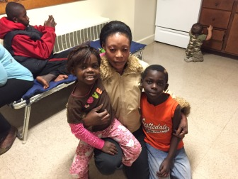 Nadia Osman with two of her five children, Martha, 4, and Batalu, 7.
