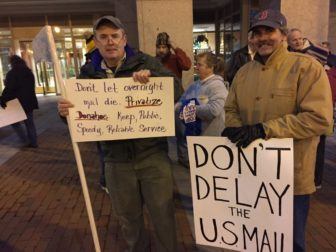 USPS union members Jim Breen, left, of Manchester, and Jim Oliver of Seabrook.