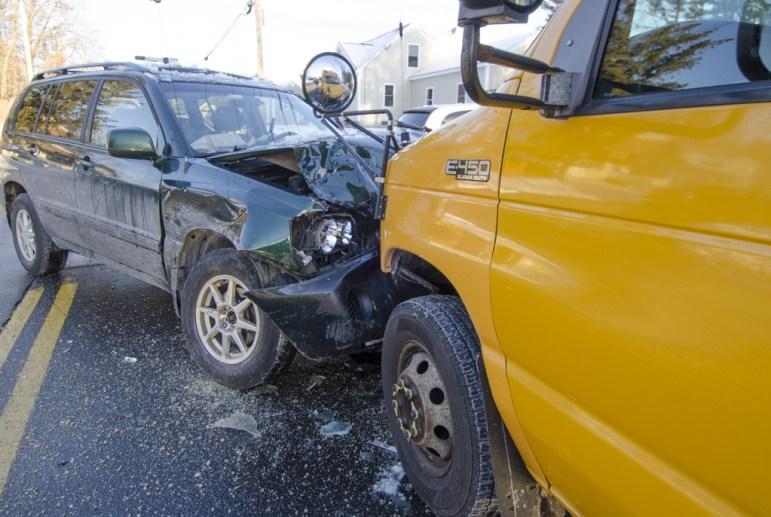 An SUV slid on icy roads, hitting a school bus head on Jan. 5, 2014.