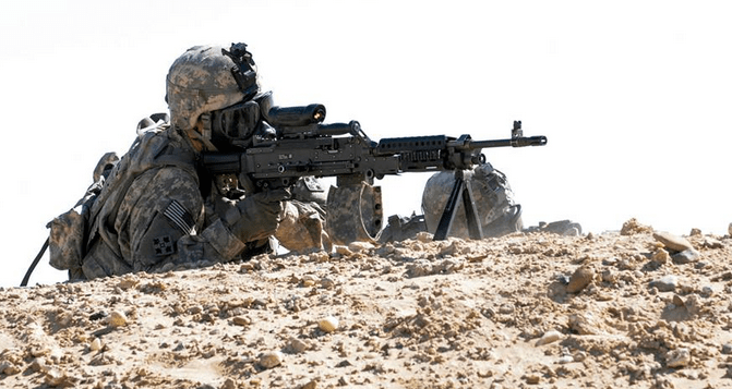 A soldier from Company B, 2nd Battalion, 8th Infantry Regiment, 2nd Armored Brigade Combat Team, 4th Infantry Division provides covering fire during a squad dismount gunnery at Udairi range complex, Camp Buehring, Kuwait, Feb. 10, 2014 as part of Operation Spartan Shield