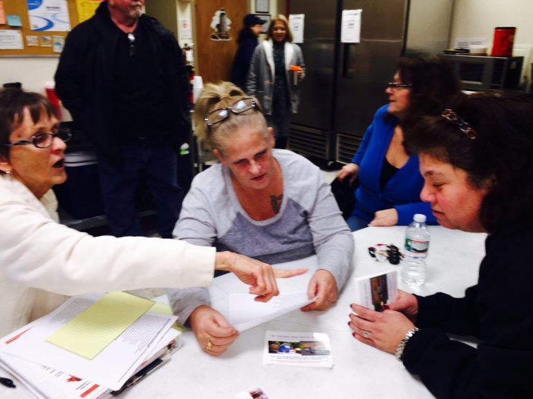 Group leaders Susan Markkievitz, left, and Heidi Sanderson discuss a postcard campaign for a NH law to support Narcan access during a recent TAM meeting in Derry.