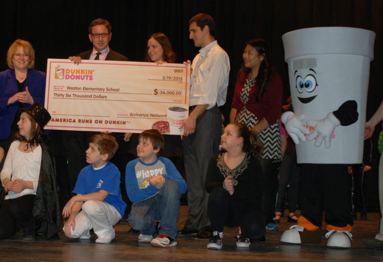 Giant check means a $15,000 boost for Manchester students, thanks to Dunkin' Donuts.