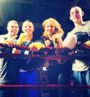 Coach Linda Murphy with some of her boxers from the Golden Gloves New England Championships in Lowell.