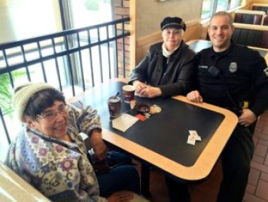 Sheila Pratt, left, Lucette Vallee, center, and Manchester Police Officer Brian Karoul at Second Street McDonald's.
