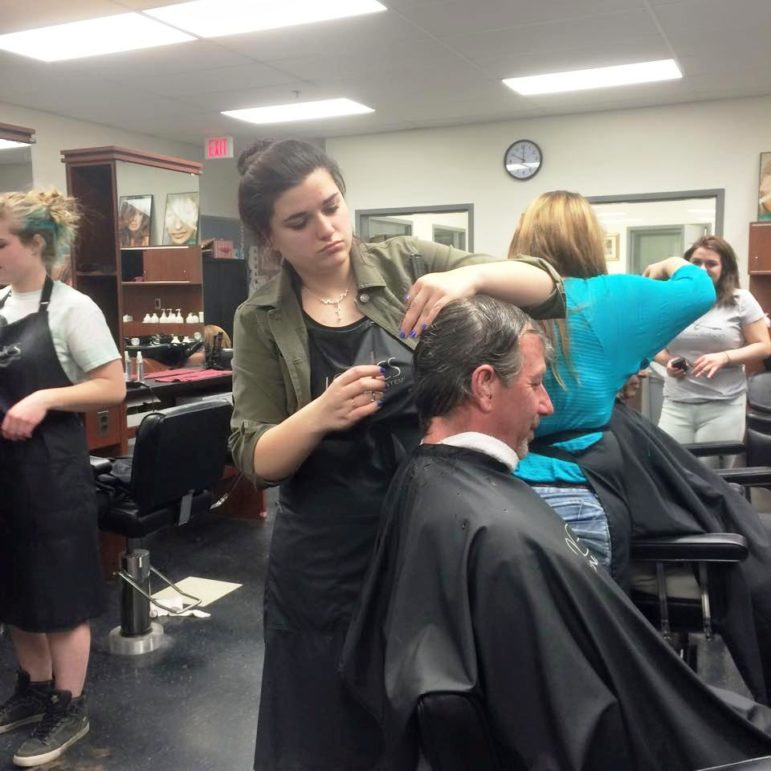 Students provided makeovers for a group of veterans from the Liberty House.
