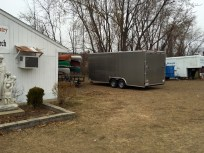 The silver trailer sits next to the Blessed Sacrament food pantry, some kayaks and a Boy Scout trailer.
