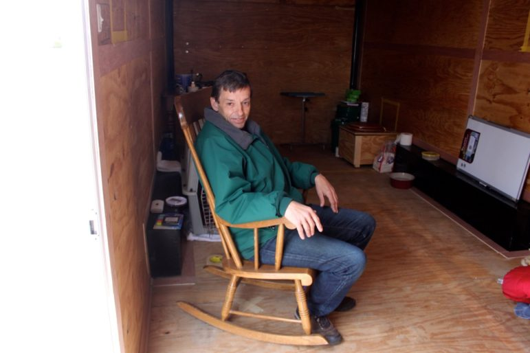 Keith Howard makes himself at home inside NH's first 'Liberty Home,' a 170-square-foot cargo trailer.