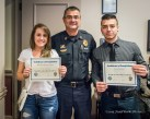 Sabrina Olivera Sotole, left, and Luan Sanches, right, with Manchester Police Chief David Mara.