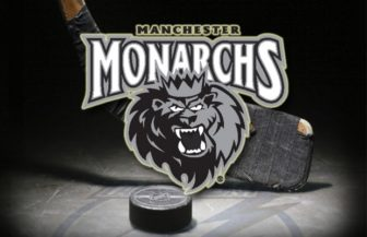 Monarchs logo stick and puck - (American Hockey League)