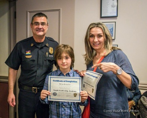 Mirza Kruscica, center with mom Anela Kruscica, and Chief David Mara.