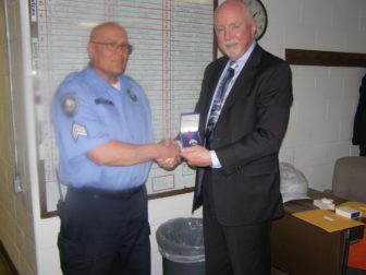 Corrections Sgt. Robert Parent receives commendation from NH Dept. of Corrections Commissioner William Wrenn.