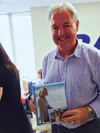 Chris Van Veen of Brookline, with his copy of Kelley Paul's book.