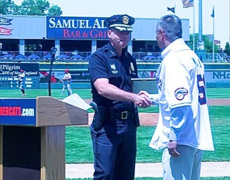 Asst Chief. Nick Willard congratulates Chief David Mara on receiving the Officer Mike Briggs Community Hero Award.