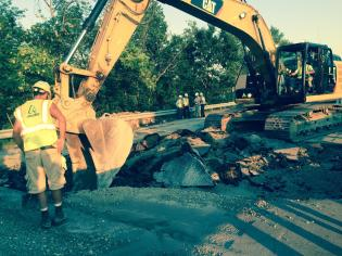 DOT workers work through the extreme heat and try to beat nightfall.