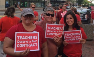 Teachers Amy Pennington, Sheila Droney, and Tracy Cosgriff rally in support of the contract at Monday's protest.