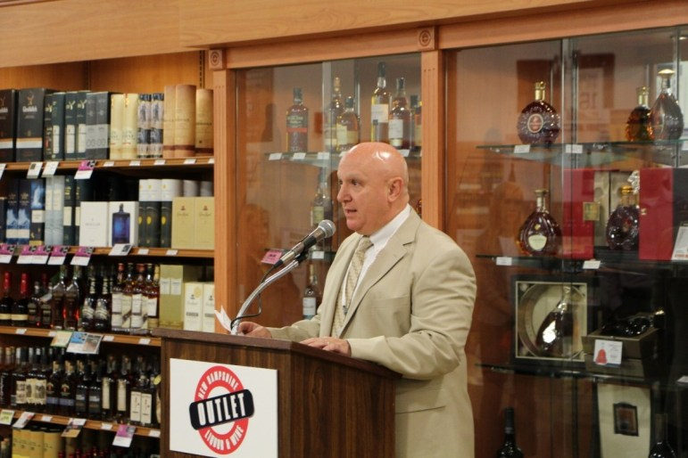 NHLC Chairman Joseph Mollica addresses a crowd at the June grand opening of New Hampshire's largest NH Liquor & Wine Outlet, located at the Rockingham Mall shopping plaza in Salem, NH