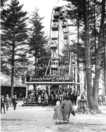 "The Ferris Wheel ""Honeymoon Express"" at Pine Island Park, c. 1925, had cars named for major cities. Cars in this photo include ""St. Louis"", ""Boston"", ""London"", and ""New York."""