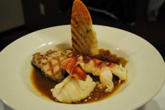 Classical French Cuisine menu: Braised monkfish, grilled tuna, and lobster Bouillabaisse