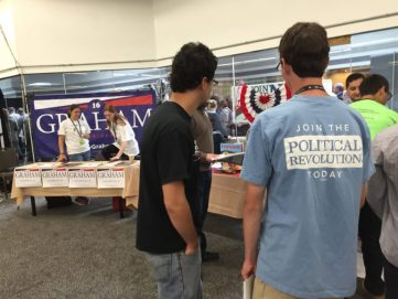 Lots of political labels on T-shirts, campaign buttons bumper stickers and signs at the No Labels convention.