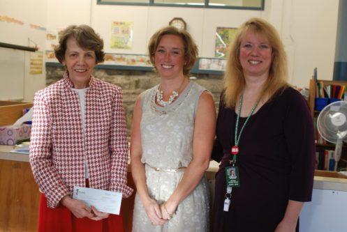 Bakersville Elementary School principal Judy Adams, Lucy Canotas, Manchester Education Association president Sue Hannan