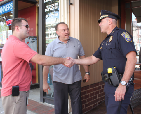 "Chief Willard gets a warm welcome as new chief during ""Coffee with a Cop"" at Cafe la Reine."