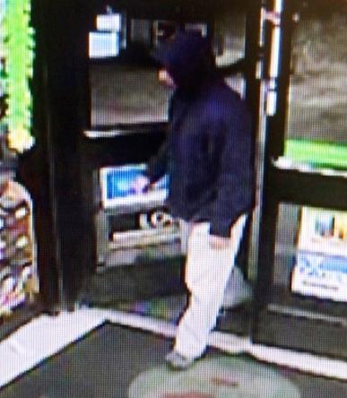 Robber suspect captured on Webster Street 7-Eleven surveillance camera.