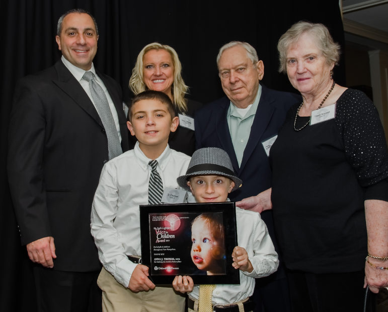 """Voice for Children Award Winner Anna Thomas and family, from left: Husband, John Thomas; sons, John or """"JJ"""" (age 10), and Chase (age 6); Anna Thomas; Anna's father, John Noetzel, and mother, Trudy Noetzel."""