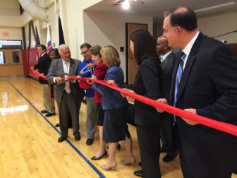 Collaborative ribbon cutting by the bi-partisan home team, with Mayor Ted Gatsas, Dick Anagnost, U.S. Sen. Jeanne Shaheen, Gov. Maggie Hassan, U.S. Sen. Kelly Ayotte and Congressman Frank Guinta.