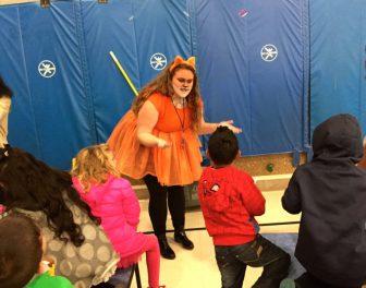 West senior Lauren Boisvert explains her costume to Parker Varney students in advance of Oct. 31 Haunted Hallway.