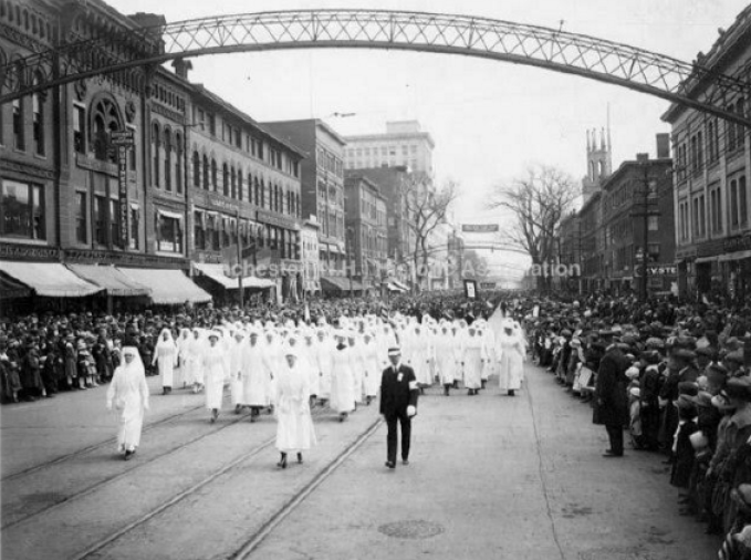 Parades have always taken on a festive air in Manchester, including this one (headed north, incidentally) on Elm Street. (Manchester Historic Association Photo)