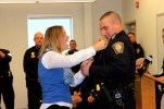 Capt. Michael Begley gets pinned by wife Lisa during Monday's promotion ceremony.