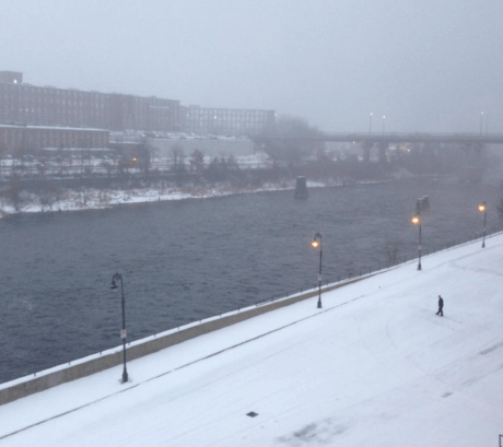 Snowy haze over the Merrimack River at the Manchester Millyard Tuesday morning.