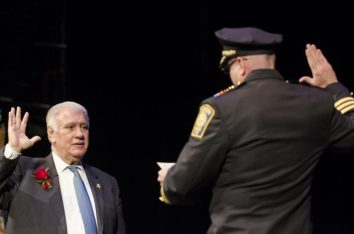 Mayor Ted Gatsas is sworn in as the 47th mayor of Manchester by Manchester Chief of Police Nick Willard.