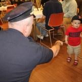 Chief Nick Willard tries to coax a fist bump from a future MPAL kid.