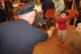 Chief Nick Willard tries to coax a fist bump from a future MPAL kid.