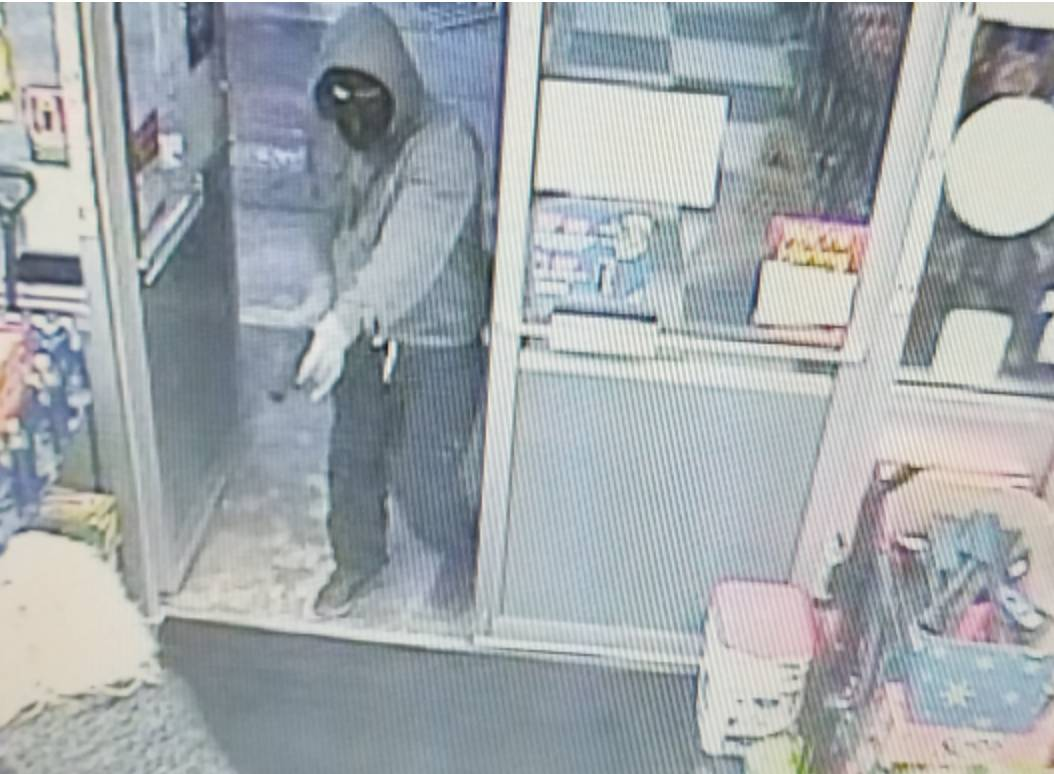 Police searching for three suspects who robbed convenience store at gunpoint