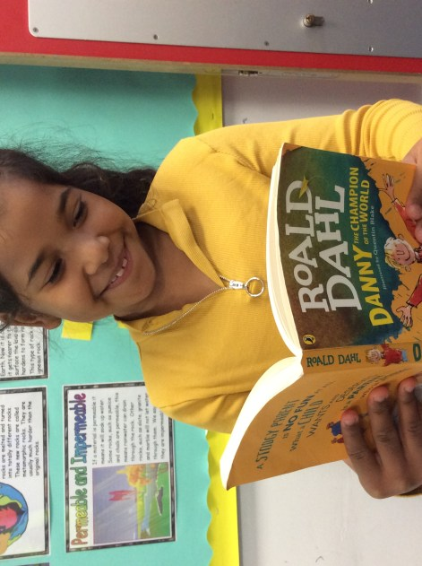 Read Manchester and Mamag G competition winner Dillara reading Roald Dahl book.
