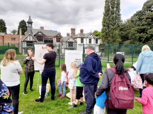 Ian Morris drawing with families around