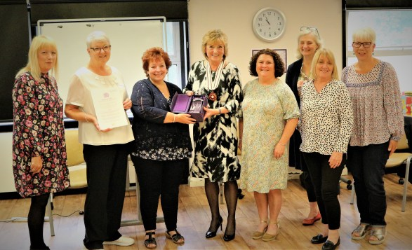 eight people receiving the Queens voluntary service award.