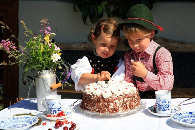 Children eating Black Forest Gateau