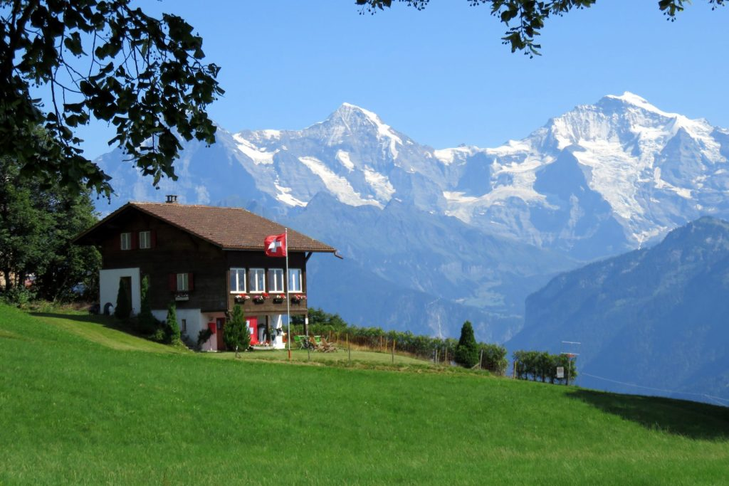 Swiss Chalet with Flag