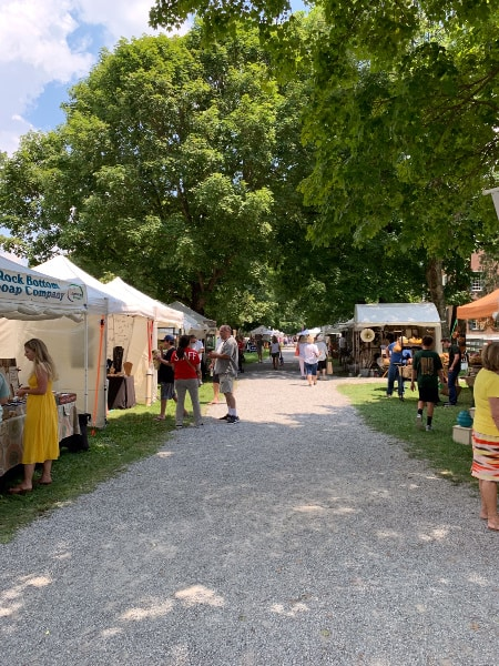 View looking down the main road at Shaker Village of the vendor booths